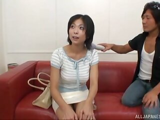 Natural breasts Asian non-specific enjoys sucking two dicks increased by rides one