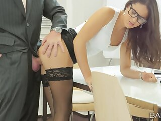 Office babe Carolina Abril makes the most excellently of will not hear of work day